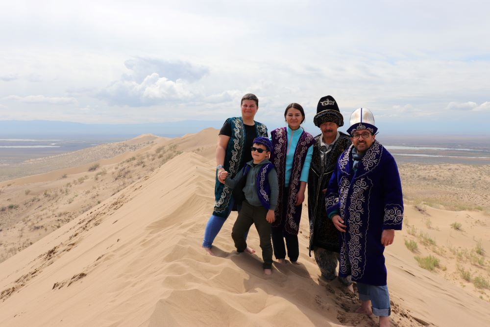 Photo session with Kazakh National clothes at Singing Dune